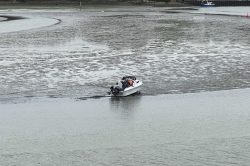 Four adults and one child have been left stranded at Sunny Corner bay in Truro, Cornwall.